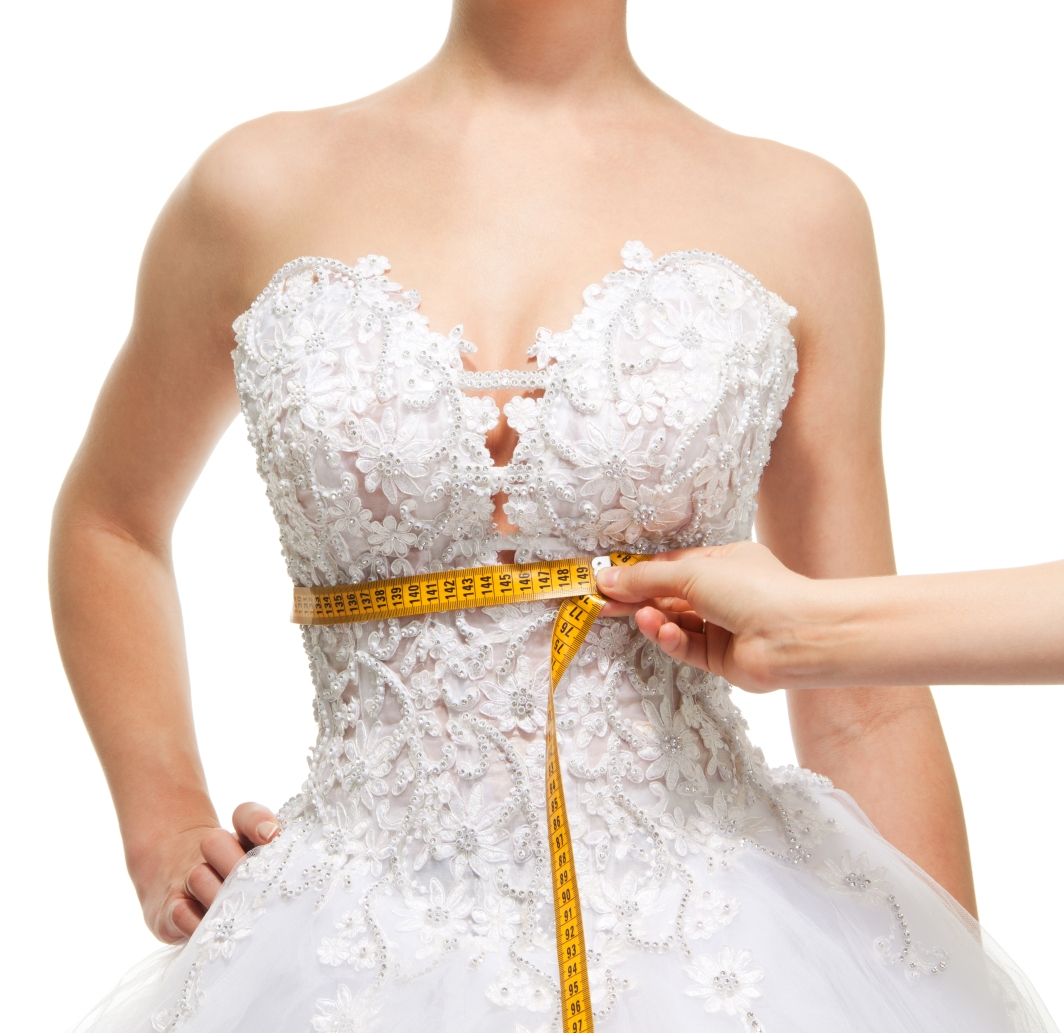 Womans-torso-in-wedding-dress-with-tape.jpg